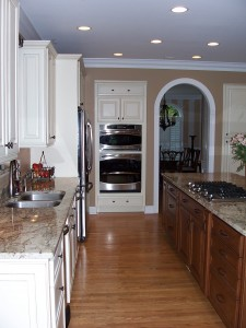 Kitchen after remodel with arched doorway
